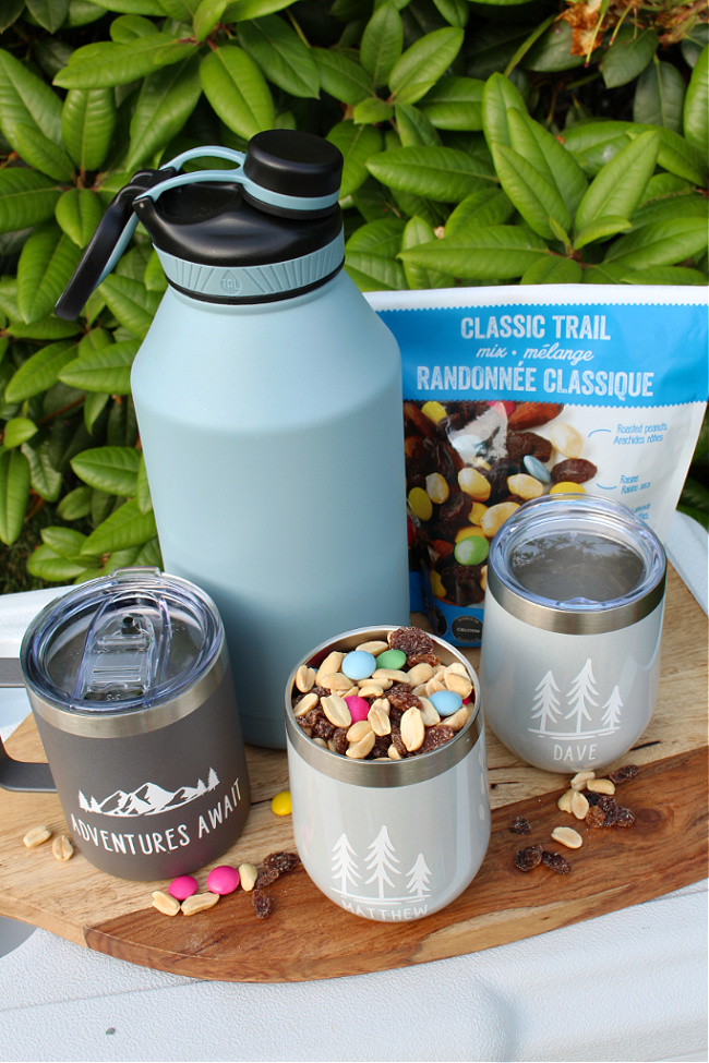 DIY personalized mugs and cups for a camping gift basket.