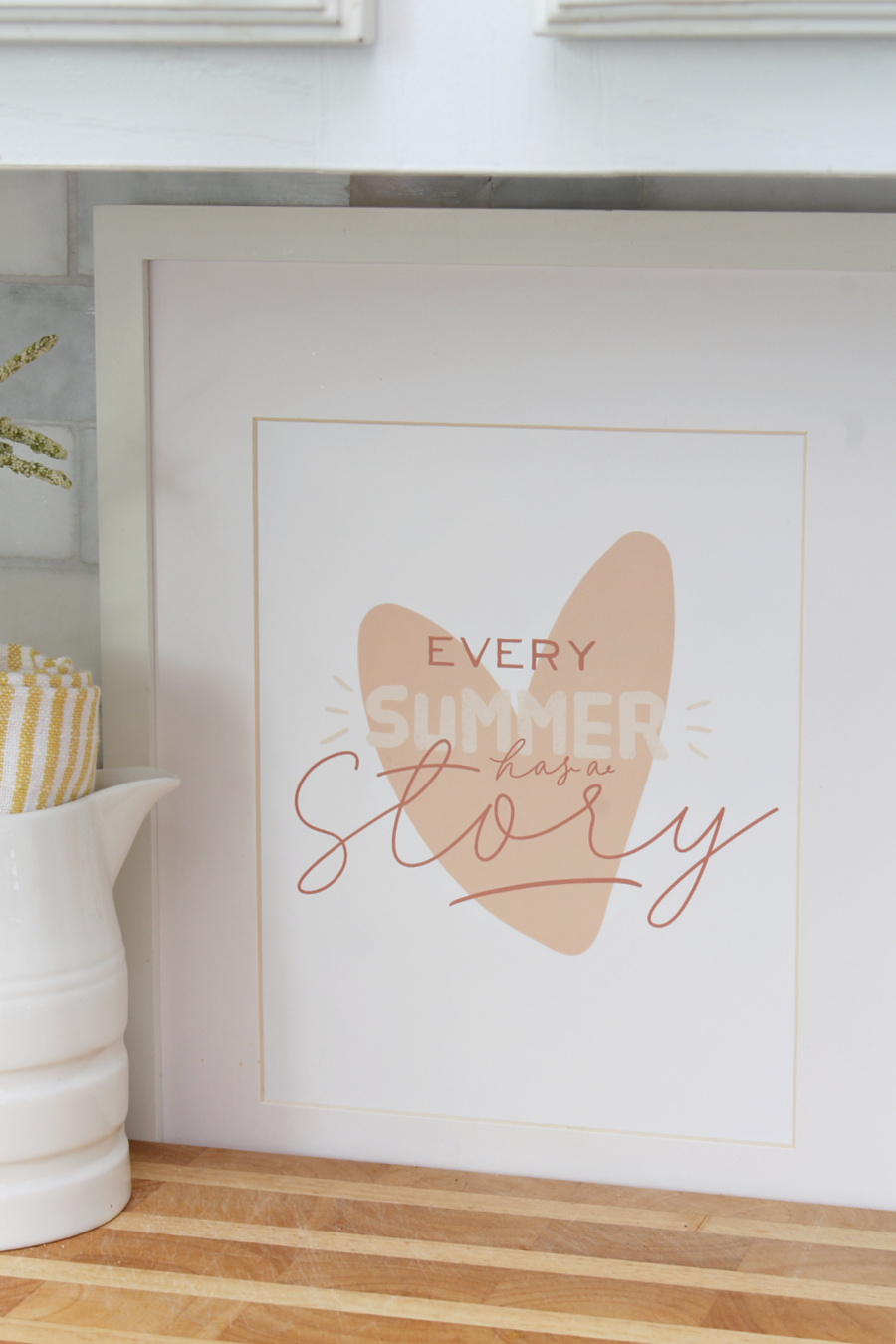 Every Summer Tells a Story free summer printable in a white frame.