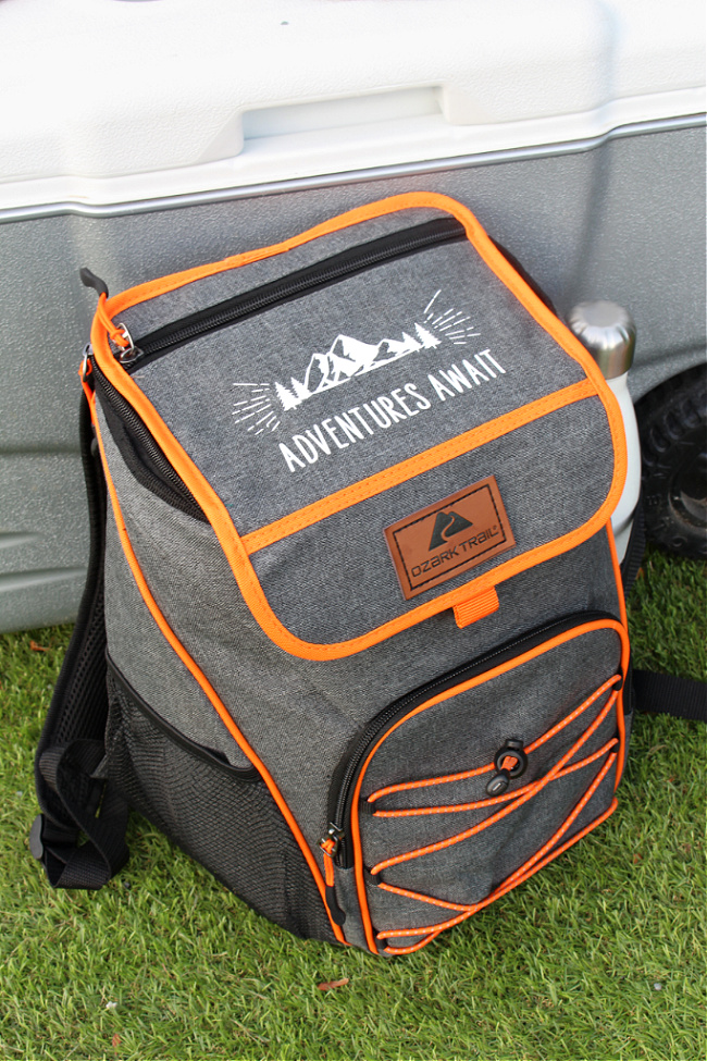 Personalized camping gift basket using an ice cooler backpack.