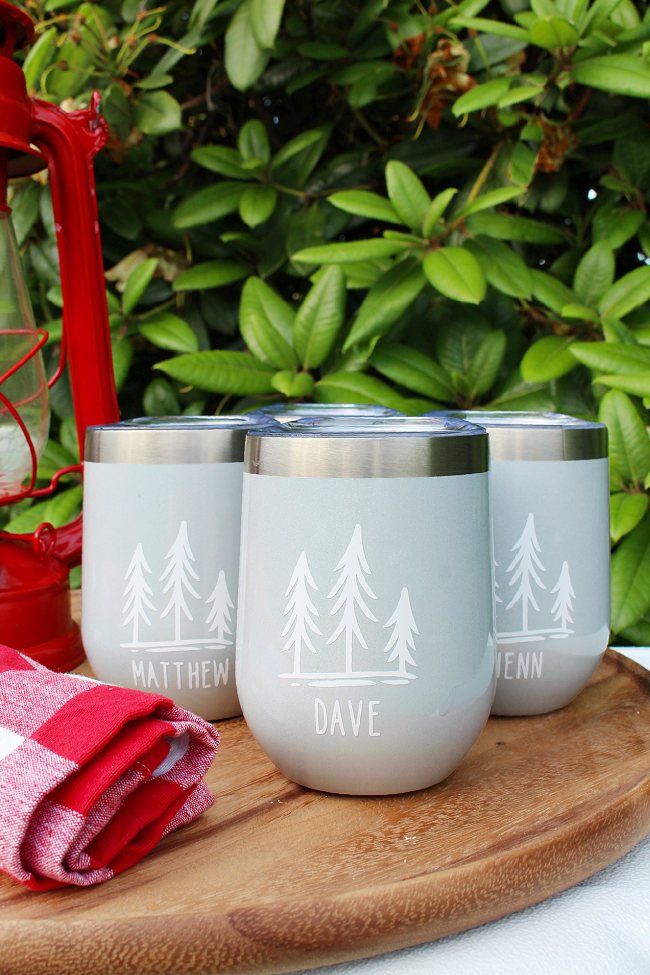 DIY personalized camping tumblers for a camping gift basket.