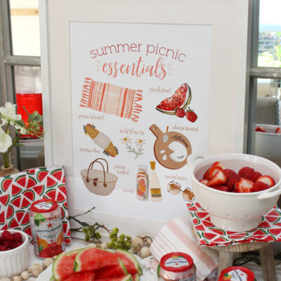 Summer Picnic Essentials free printable displayed on a side board.