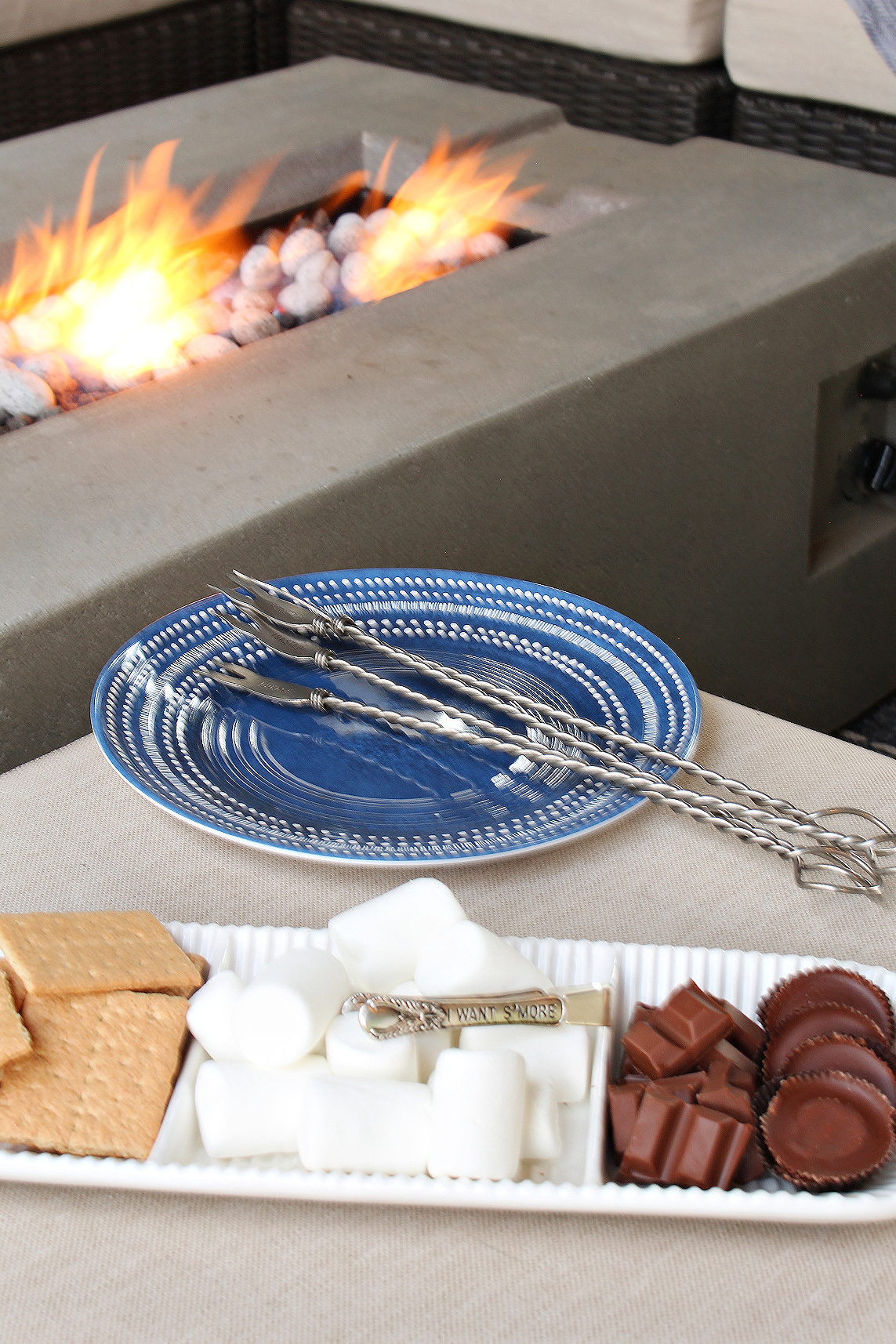 S'mores platter by a fire table.