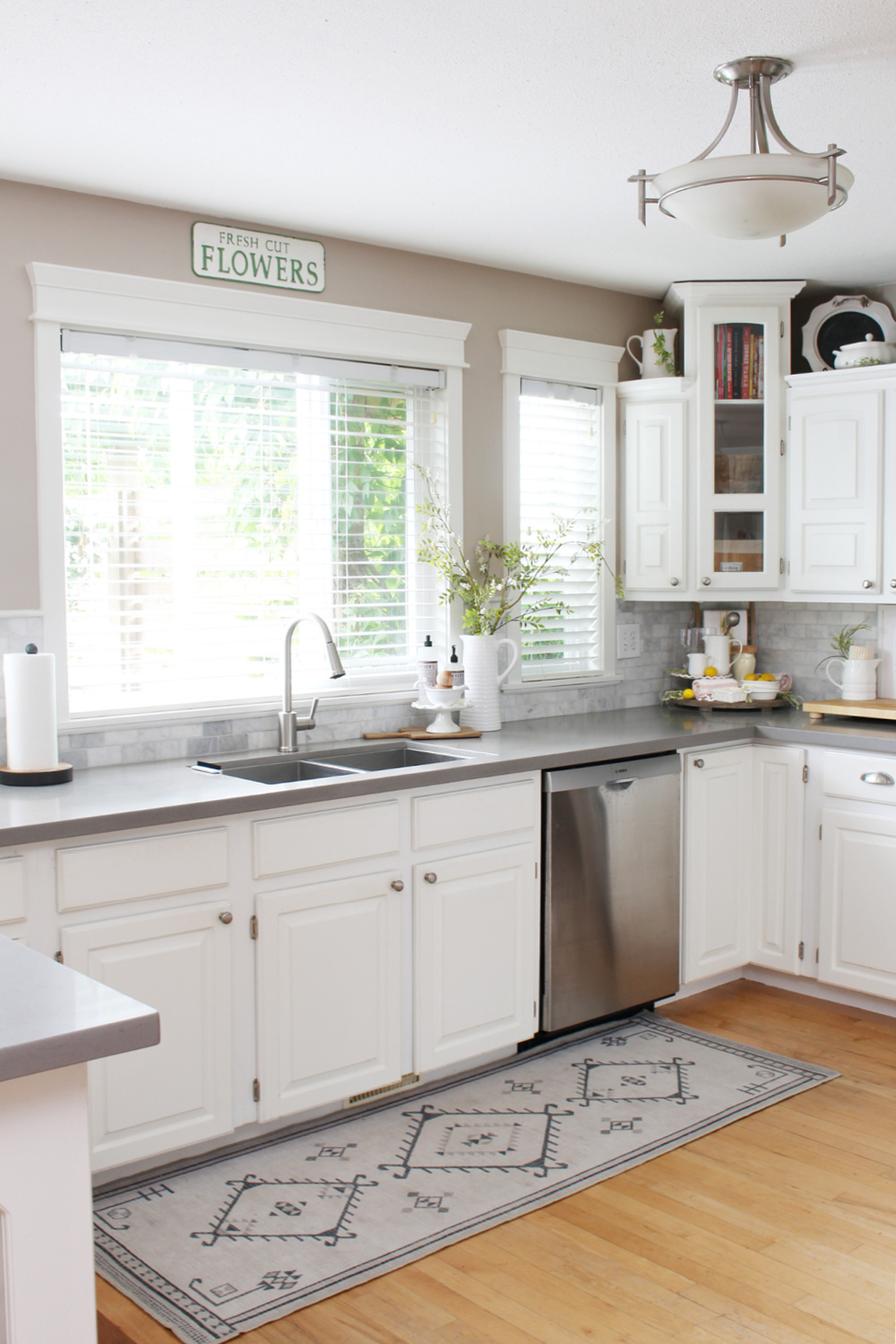 White kitchen decorated for summer with soft, muted colors for a fresh look.