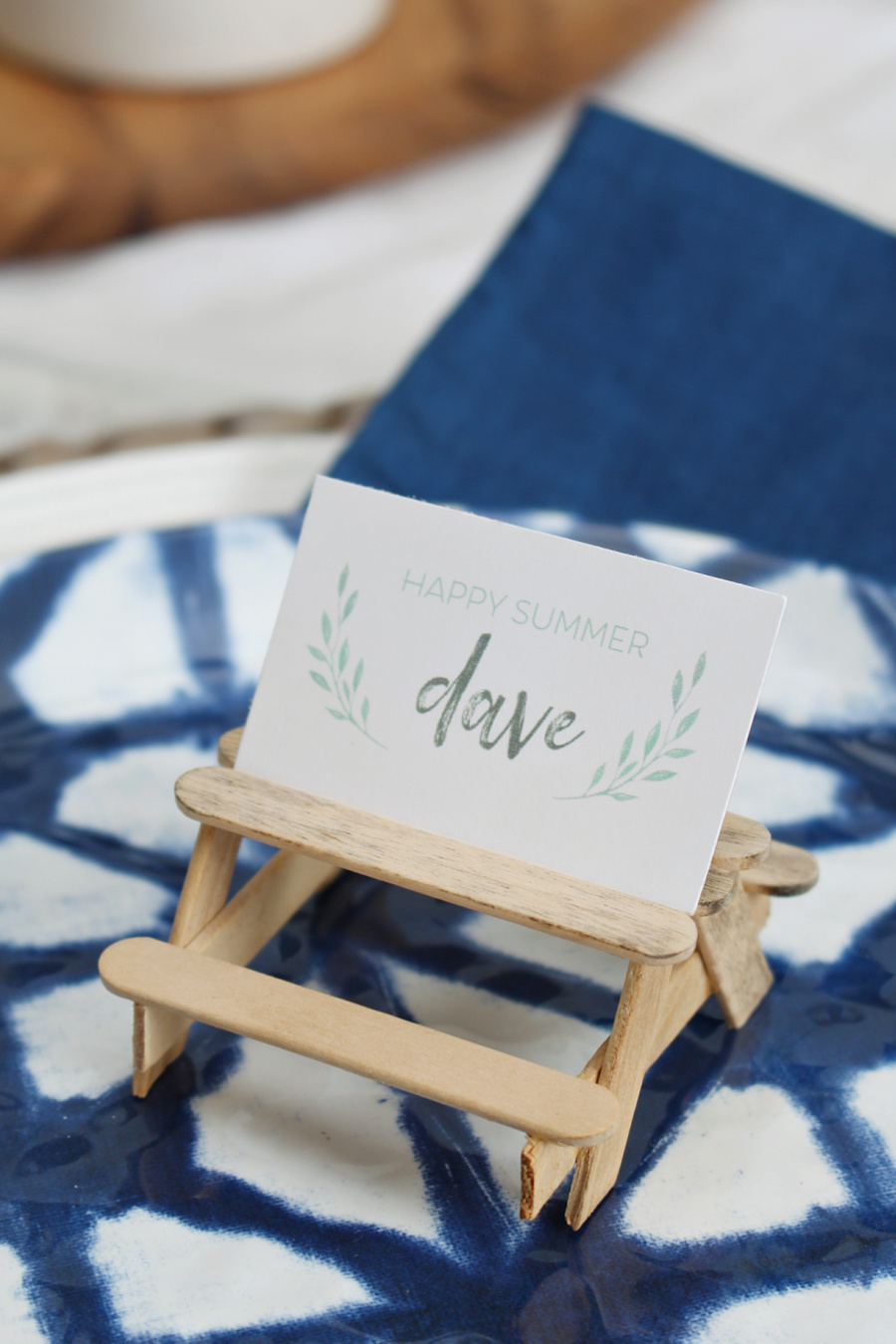 Cute popsicle stick picnic tables used for a place card holder.