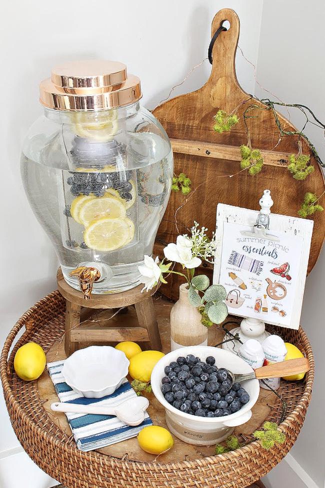 Cute beverage bar with water and fresh seasonal fruit.