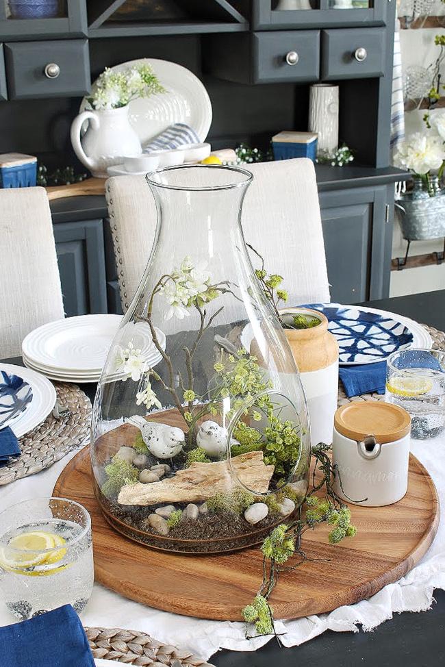 Summer centerpiece in a glass hurricane vase.