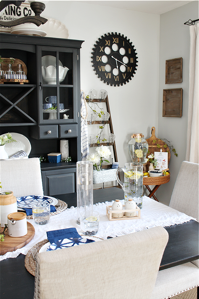 Summer dining room decorated with pops of blue and green.