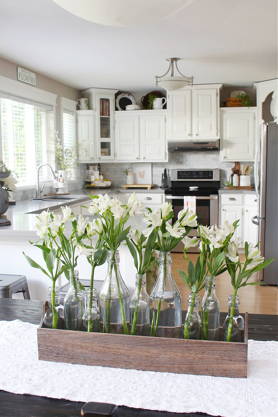 White kitchen decorated for summer.