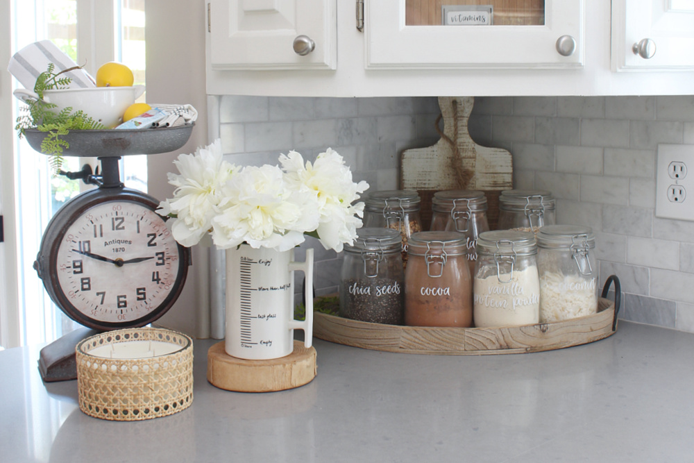 Mason jars on a tray storing items for a healthy smoothie bar.