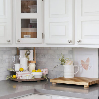 White kitchen decorated for summer with pastels for a fresh look.