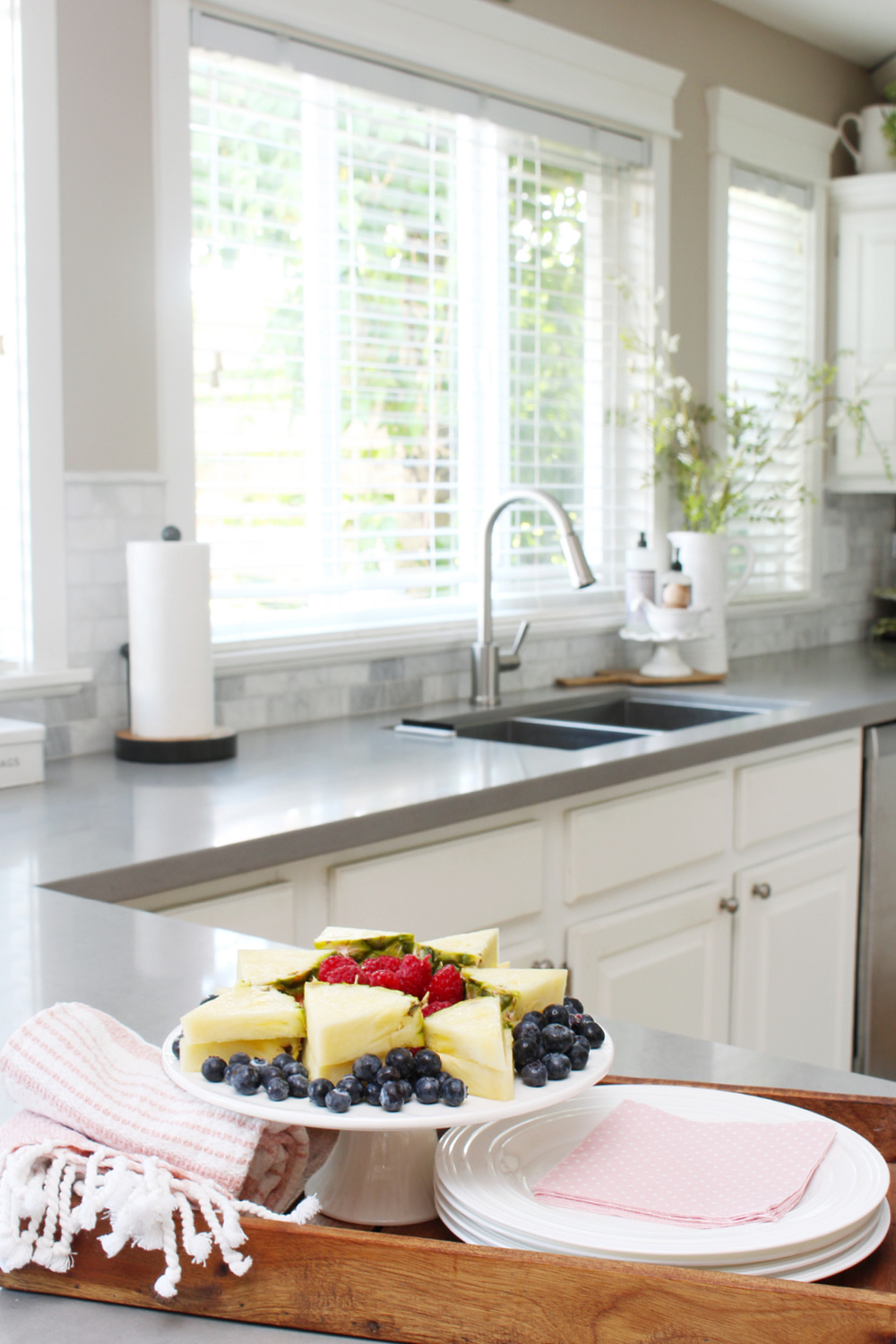 Fruit plate in a white summer kitchen.