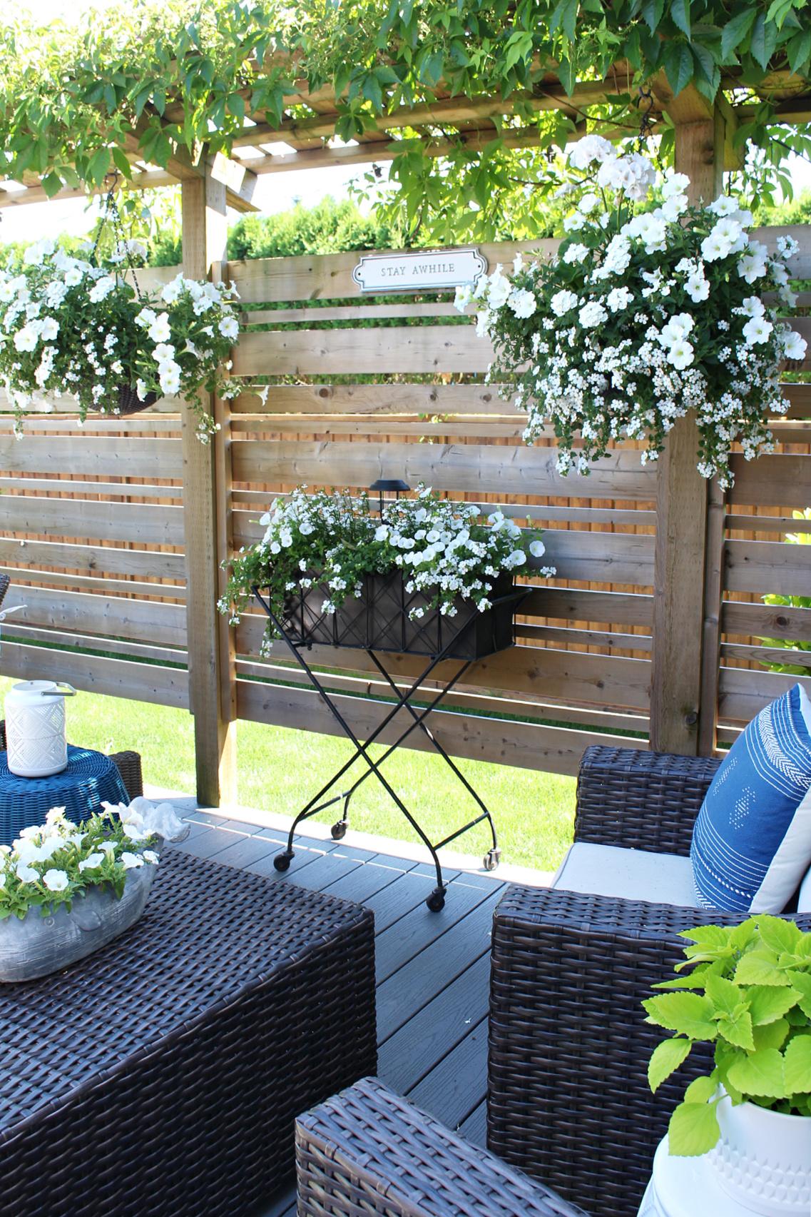 White flowers on a backyard patio.