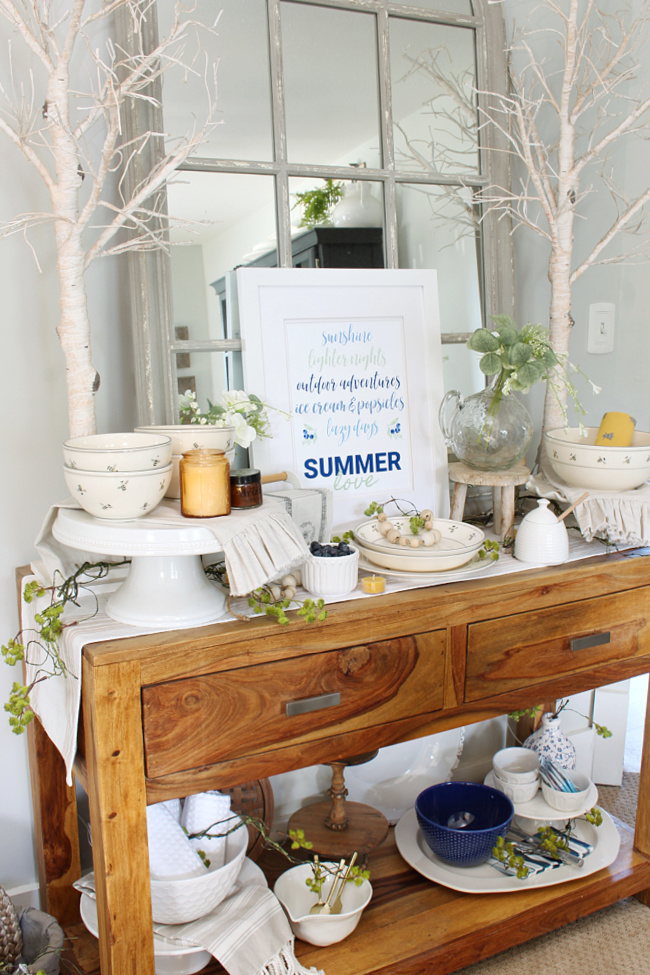 Dining room sideboard decorated for summer with blues and yellows.