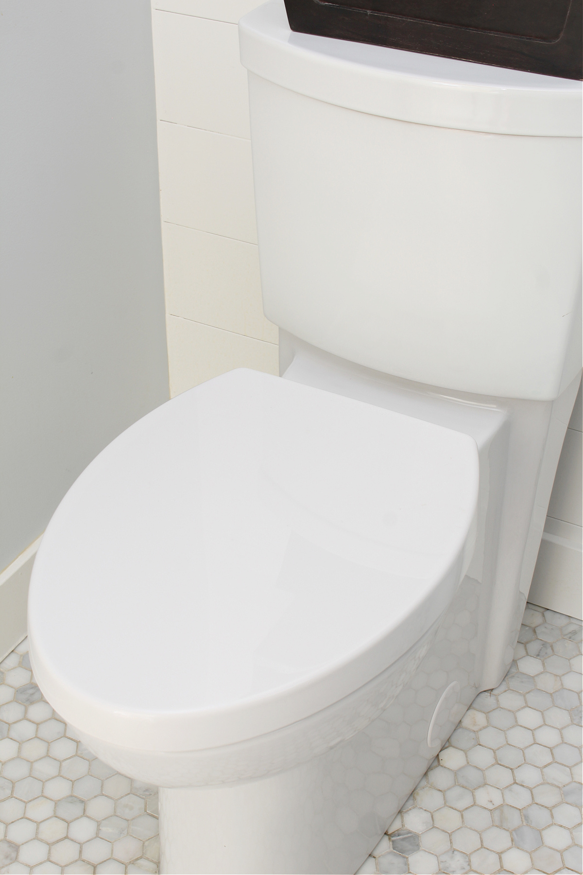 American Standard toilet with concealed trapway.