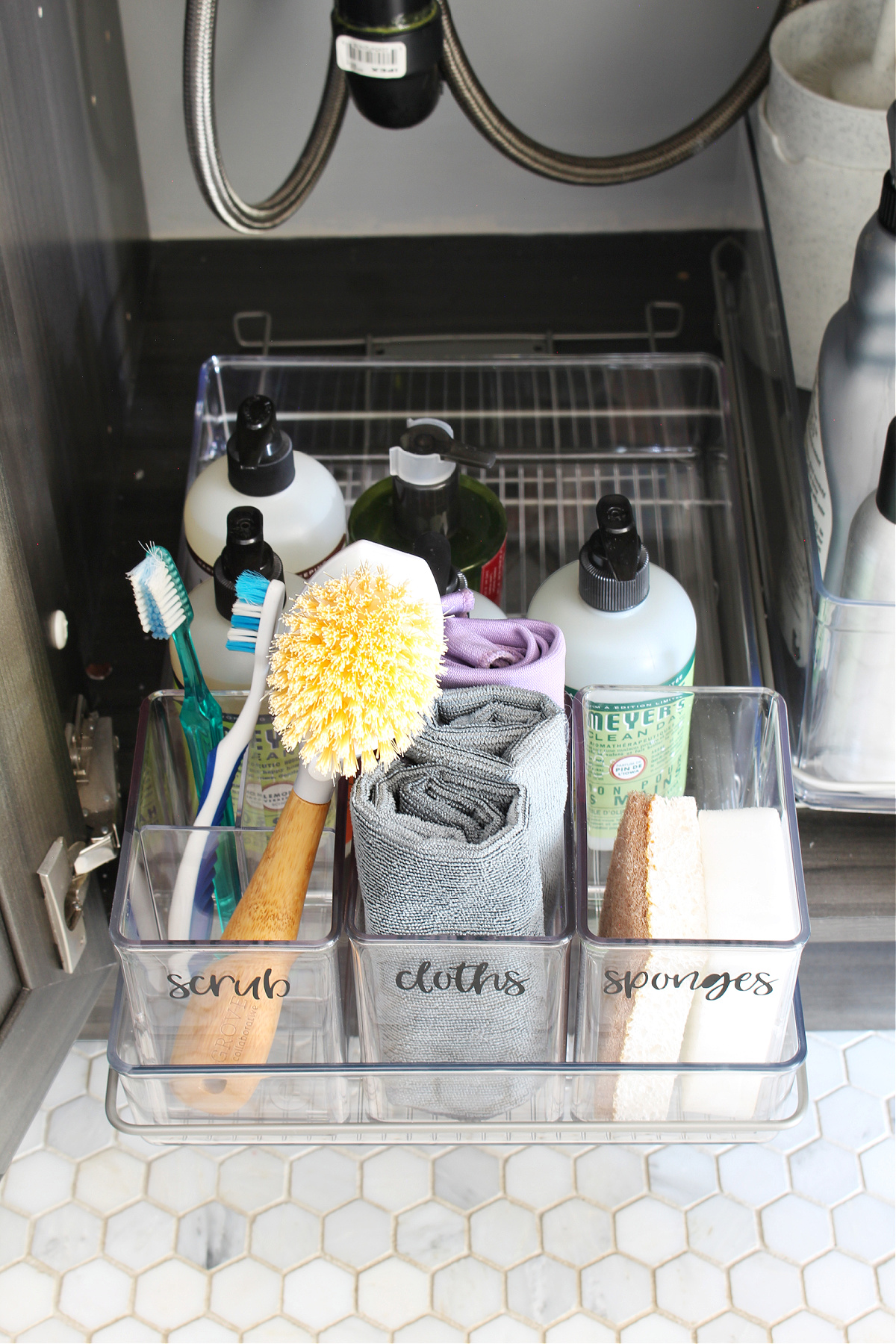 Bathroom cleaning products in a pull-out acrylic tray.