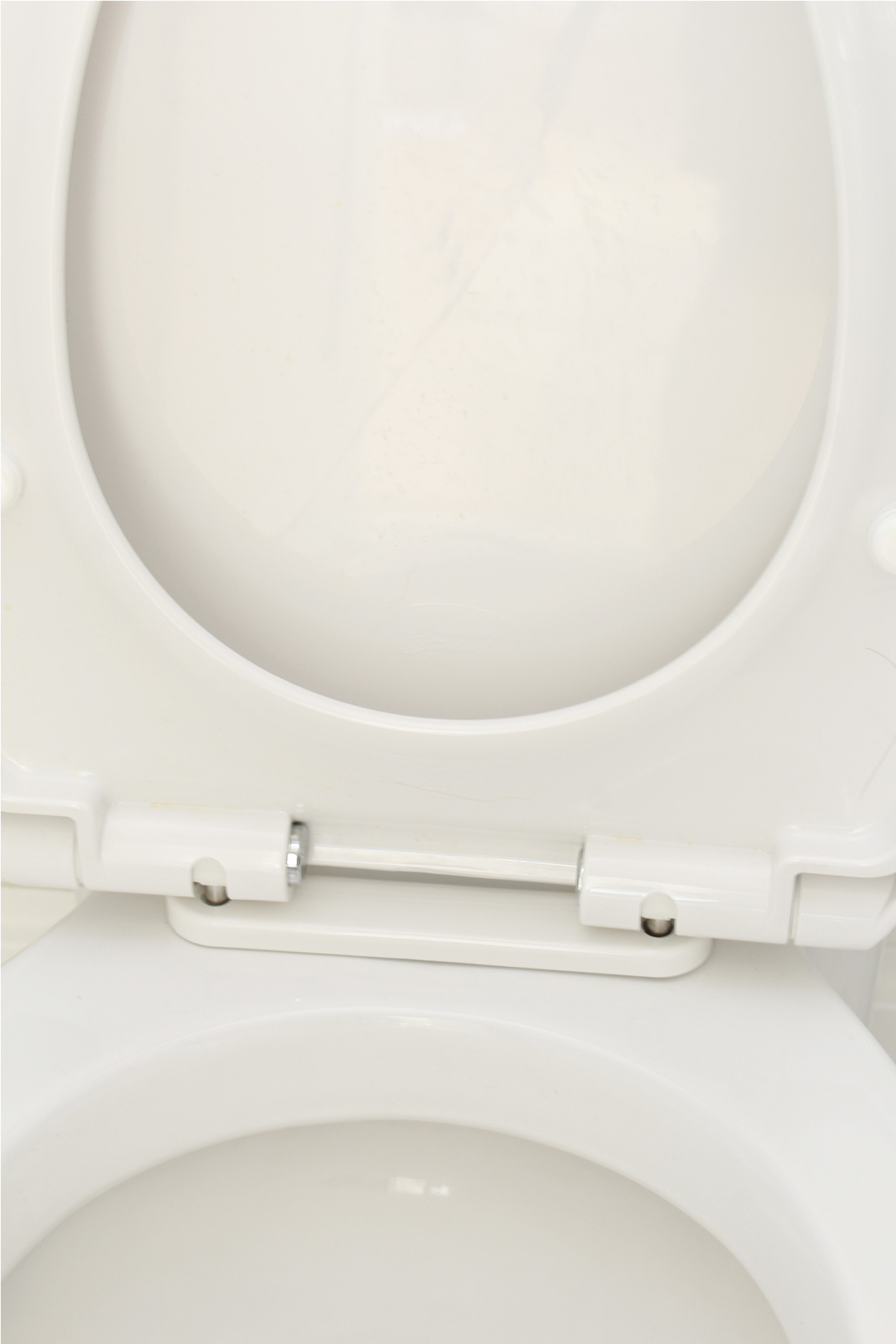 American Standard toilet with easy-to-remove toilet seat.