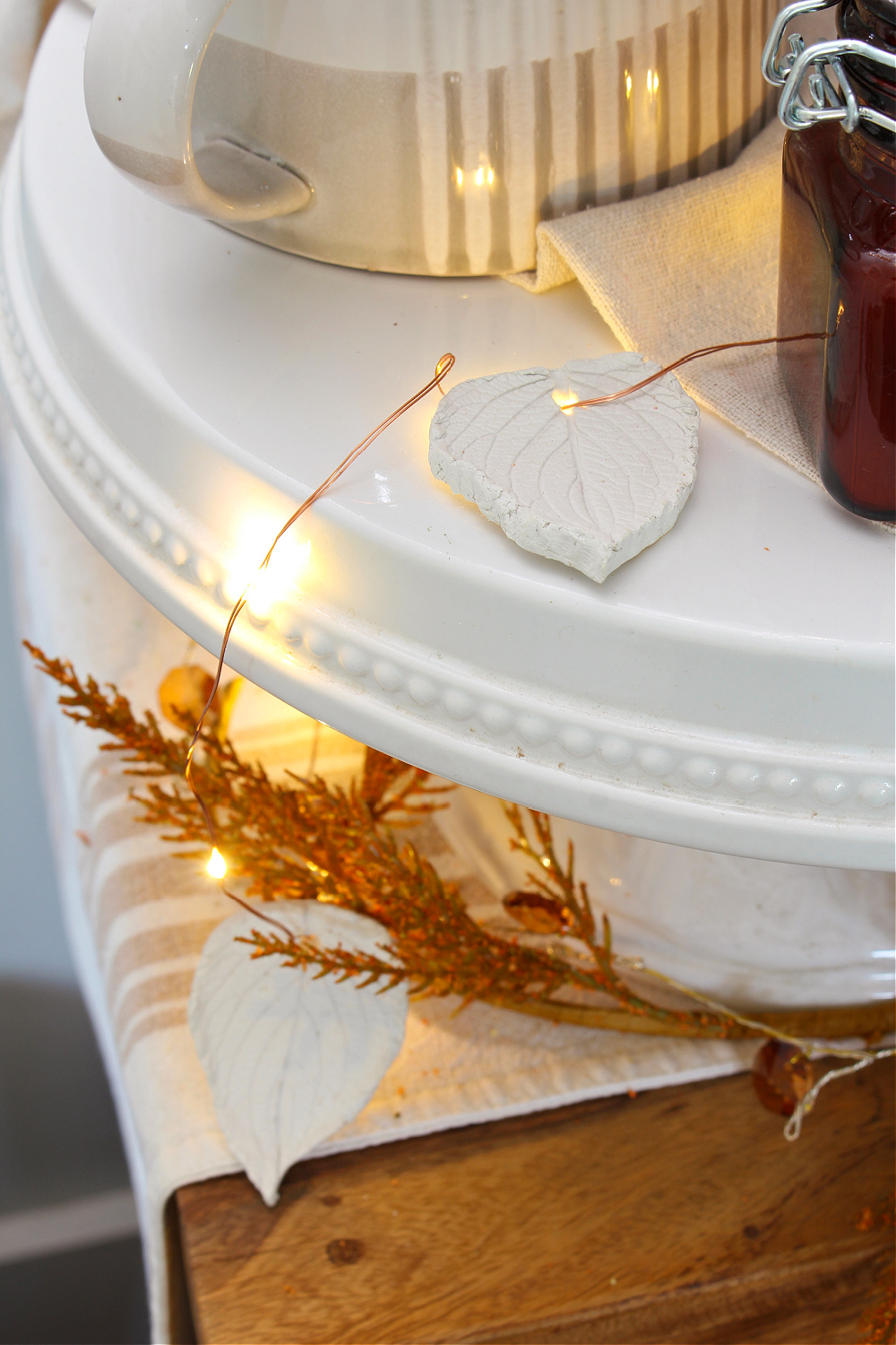 Air dry clay leaves added to twinkle lights.