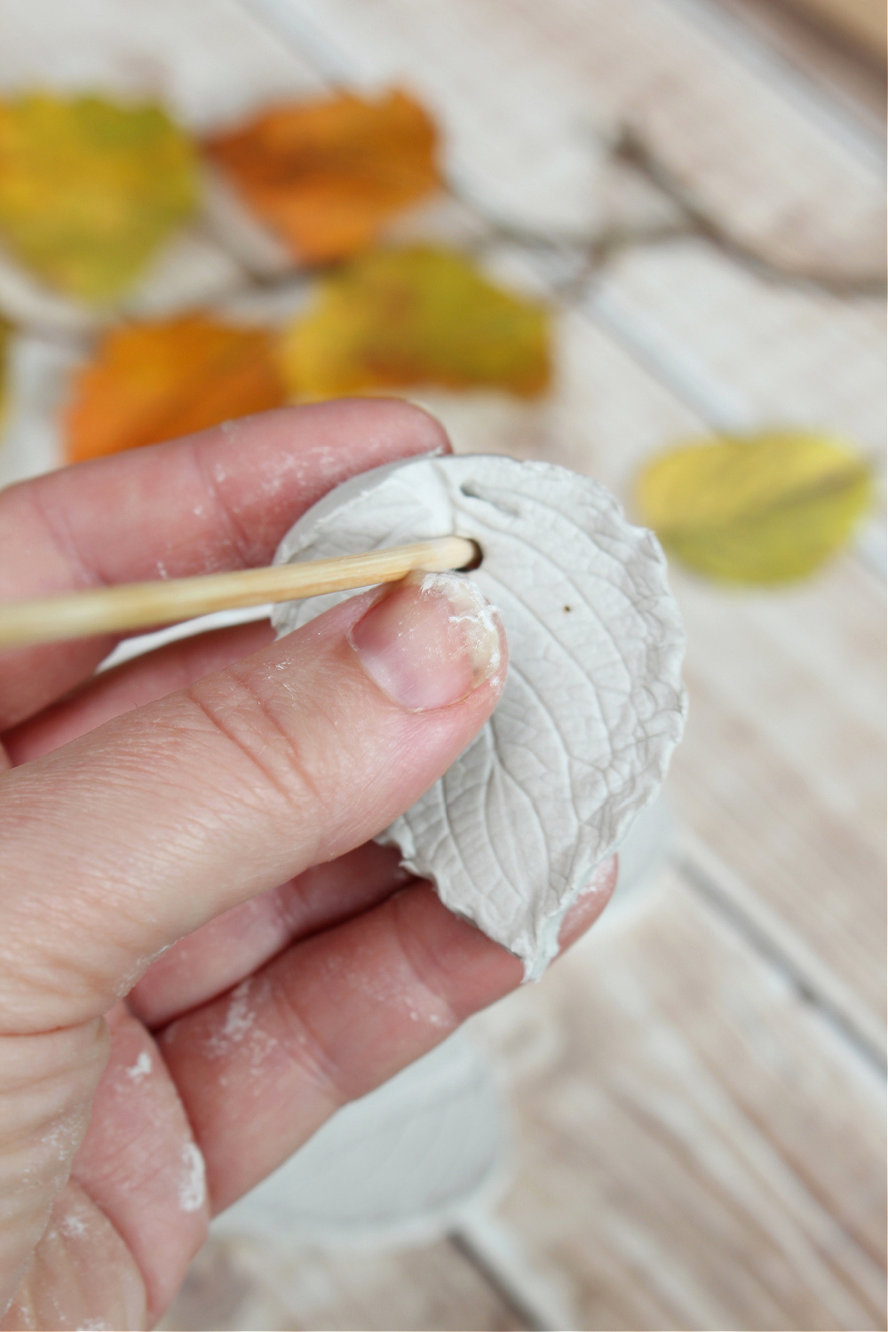 Air dry clay leaves with a wood skewer to make a hole.