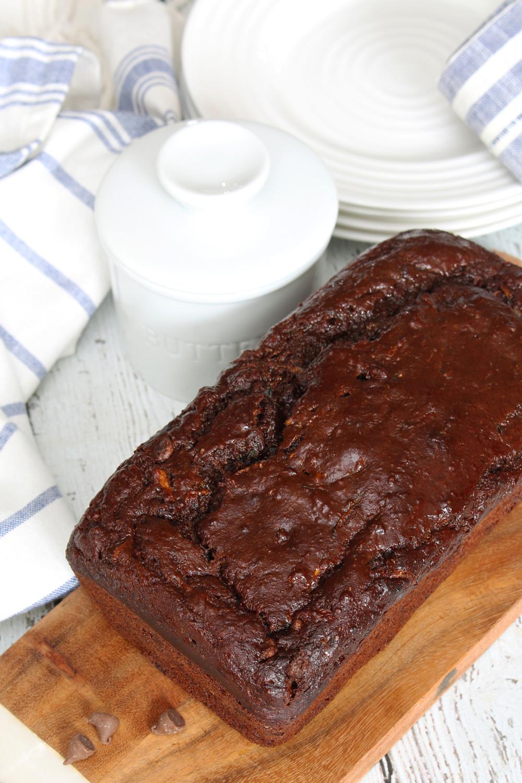 Chocolate zucchini bread on a bread board.