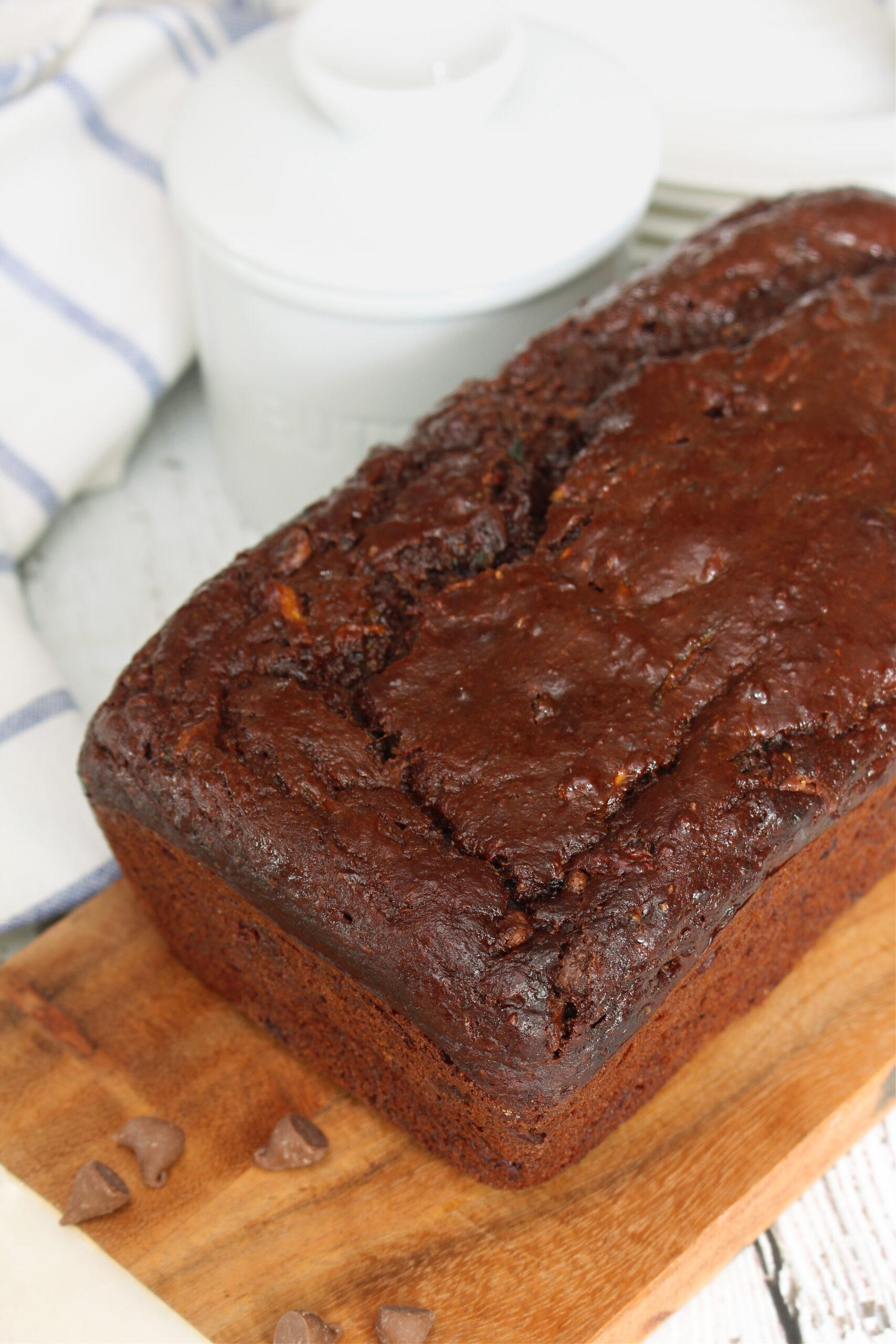 Double chocolate zucchini bread on a bread board.