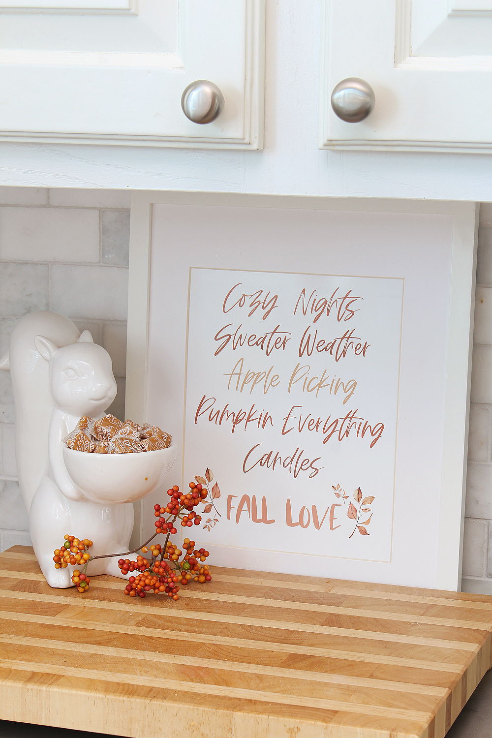Free fall printable in a frame with ceramic squirrel.