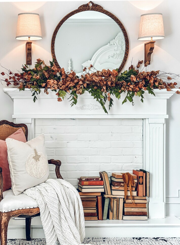 White mantel decorated for fall.