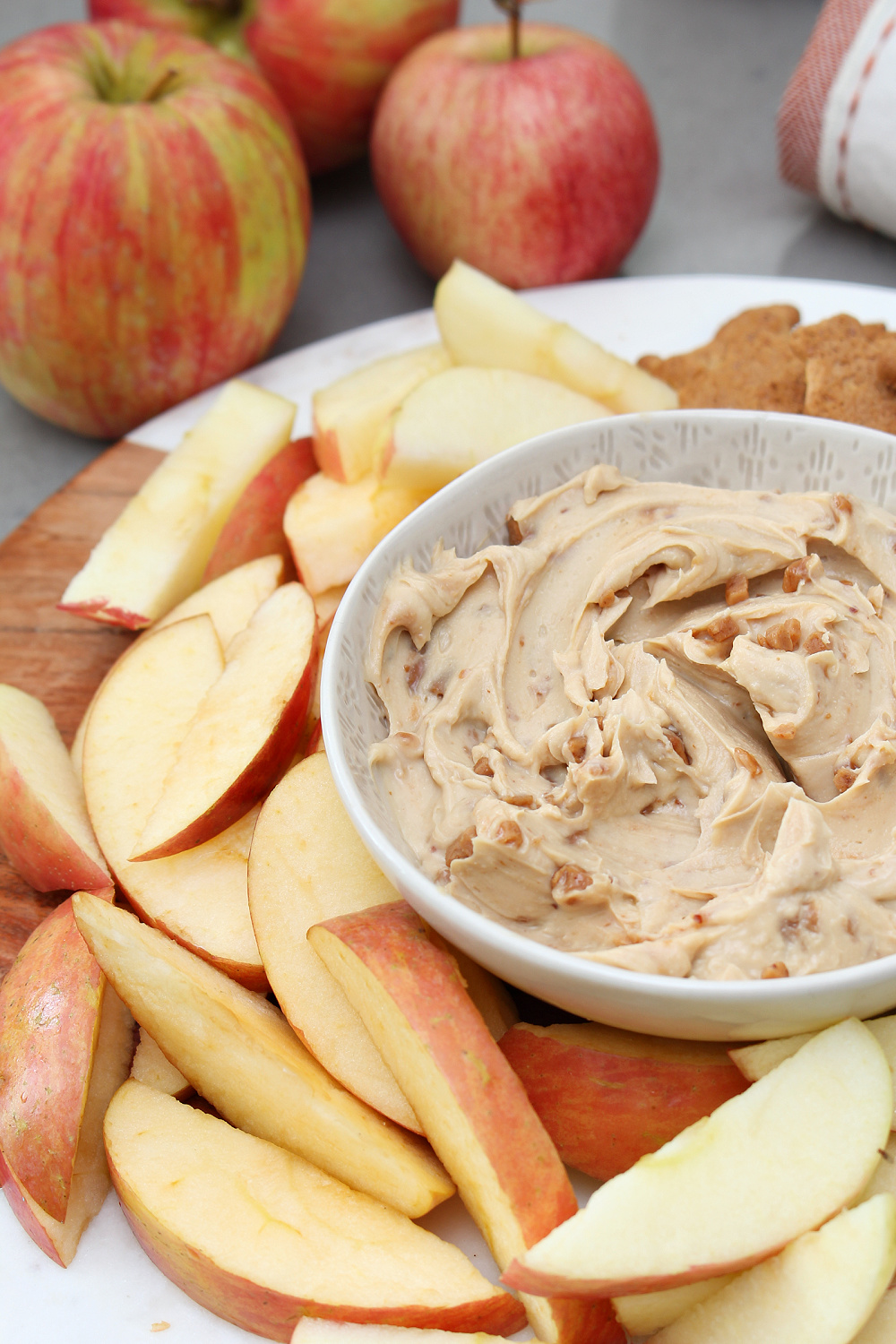 Cream cheese apple dip with sliced apples.