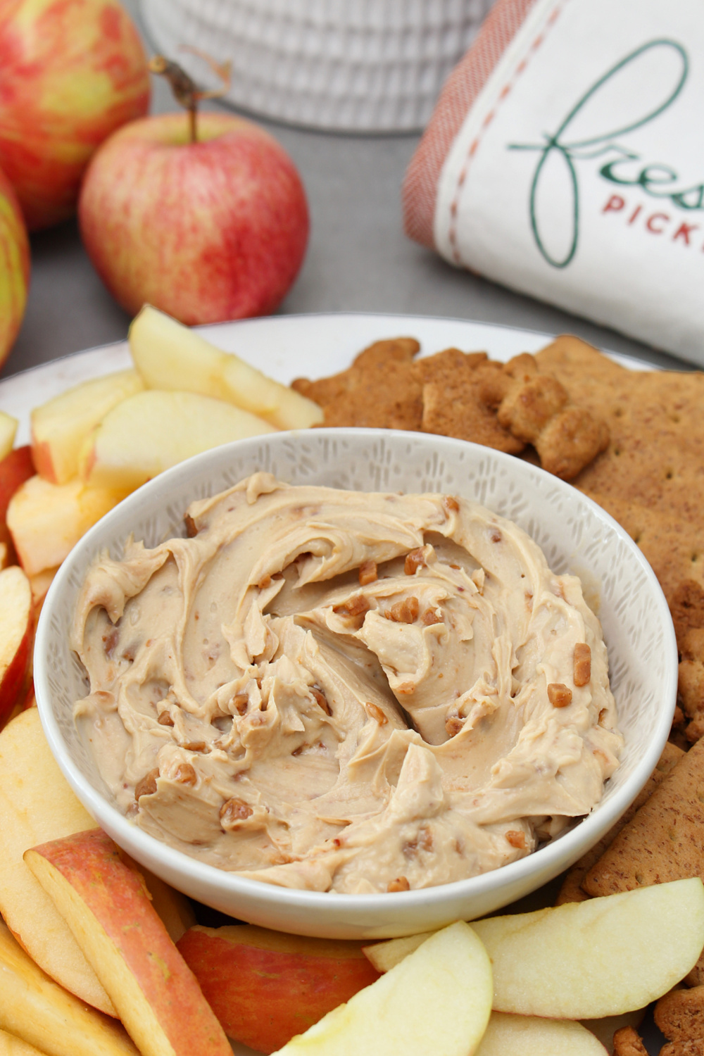 Cream cheese apple dip with apples and graham crackers.