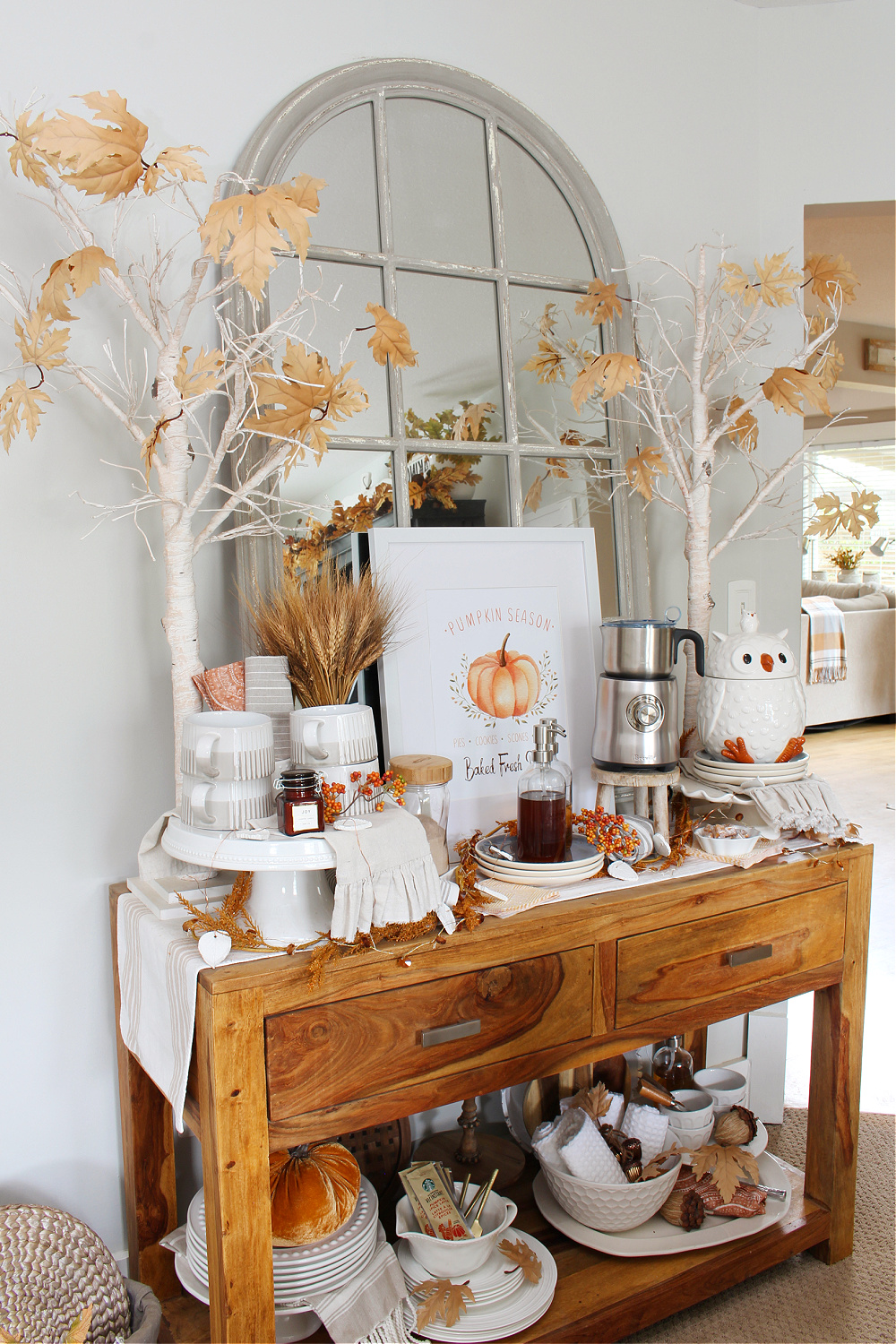 Fall coffee bar on a sideboard decorated with traditional fall colors.