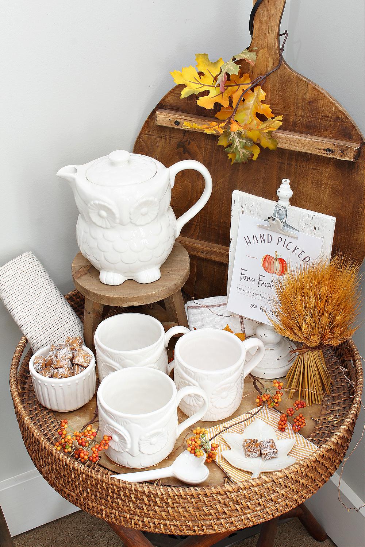 Fall vignette with owl tea pot and mugs.