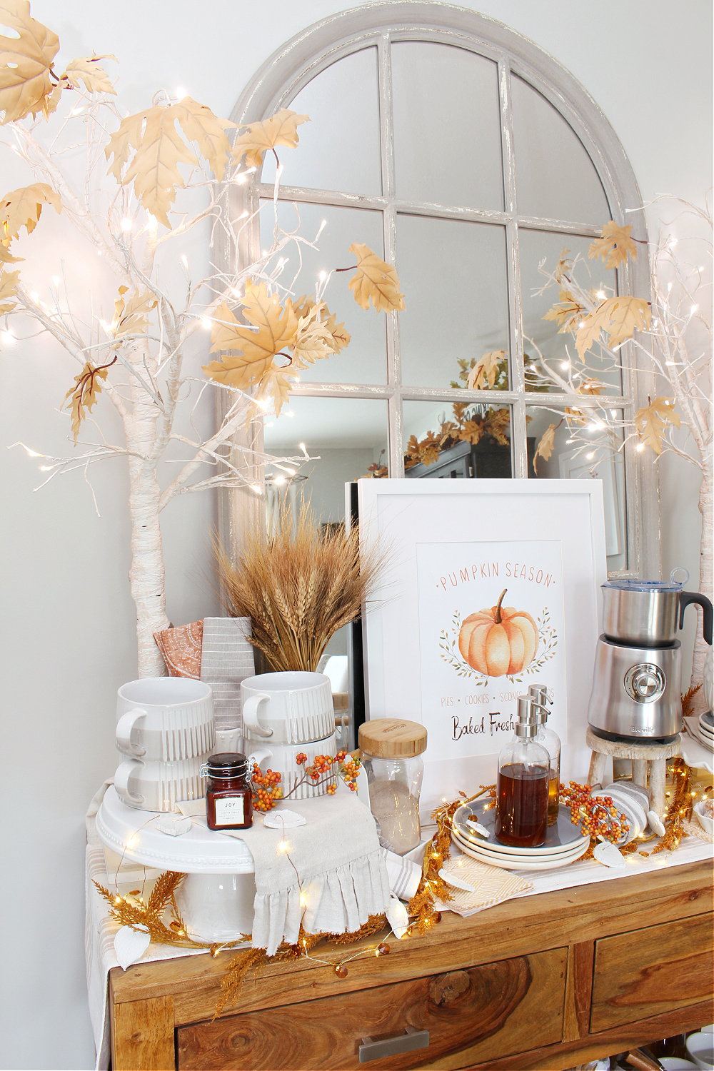 Fall coffee bar with twinkle lights and lighted trees.