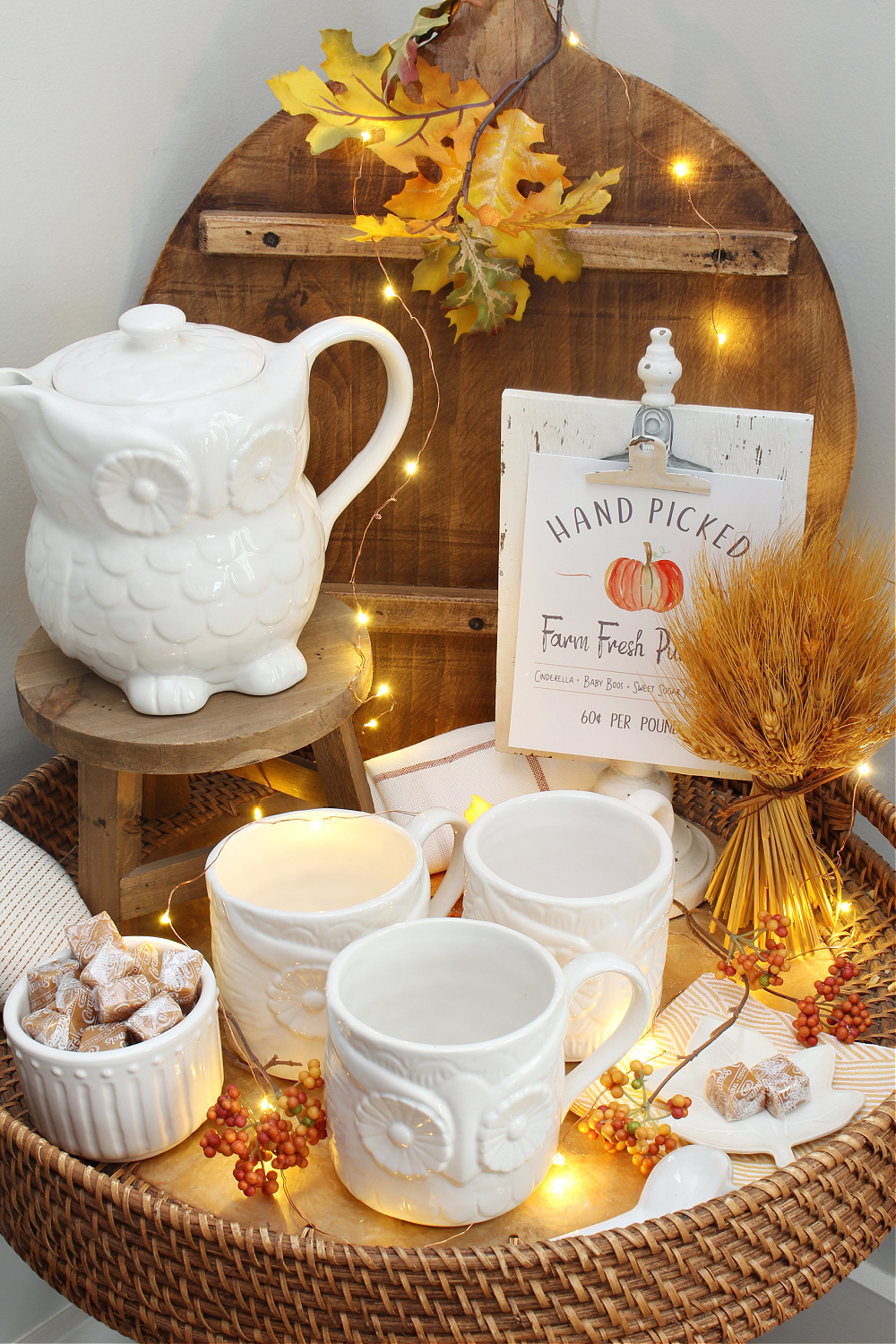 Fall vignette with owl tea pot and mugs and twinkle lights.