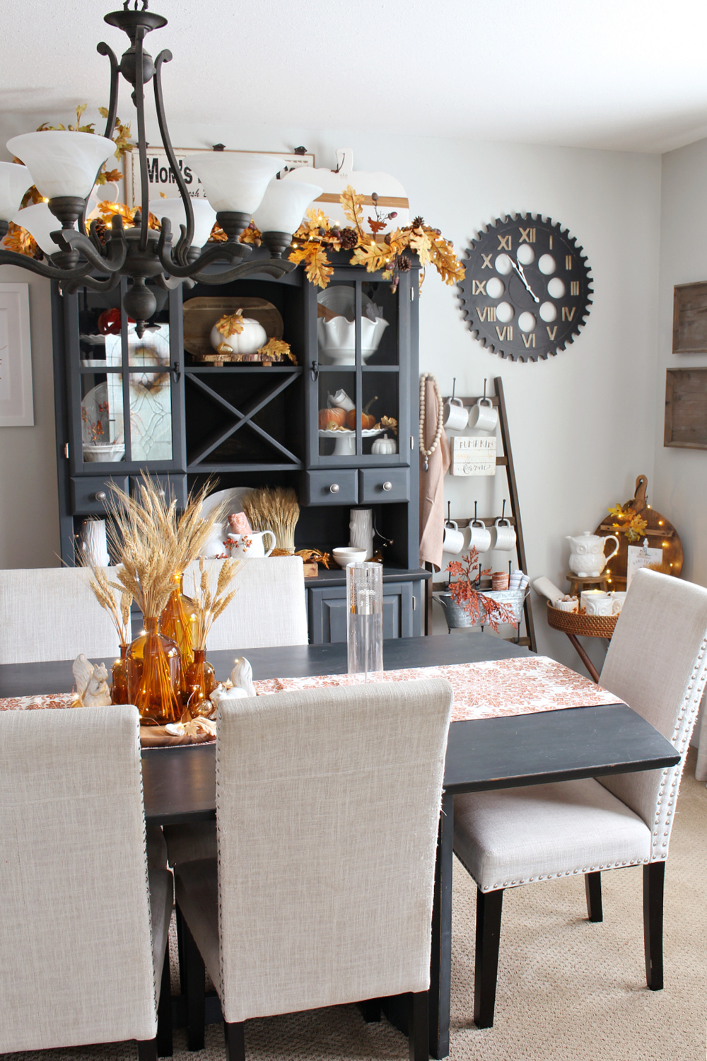 Beautiful dining room decorated for fall with traditional fall colors.