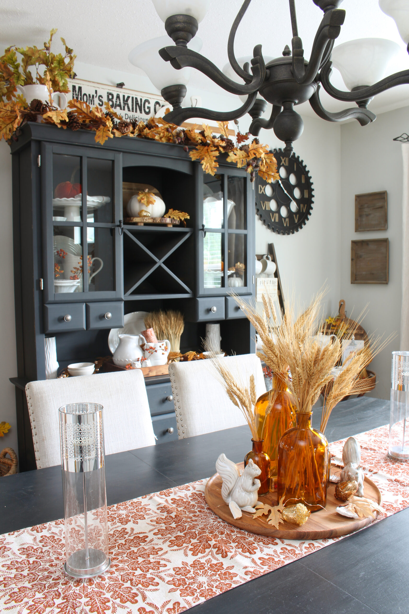 Modern farmhouse style dining room decorated for fall with traditional fall colors.
