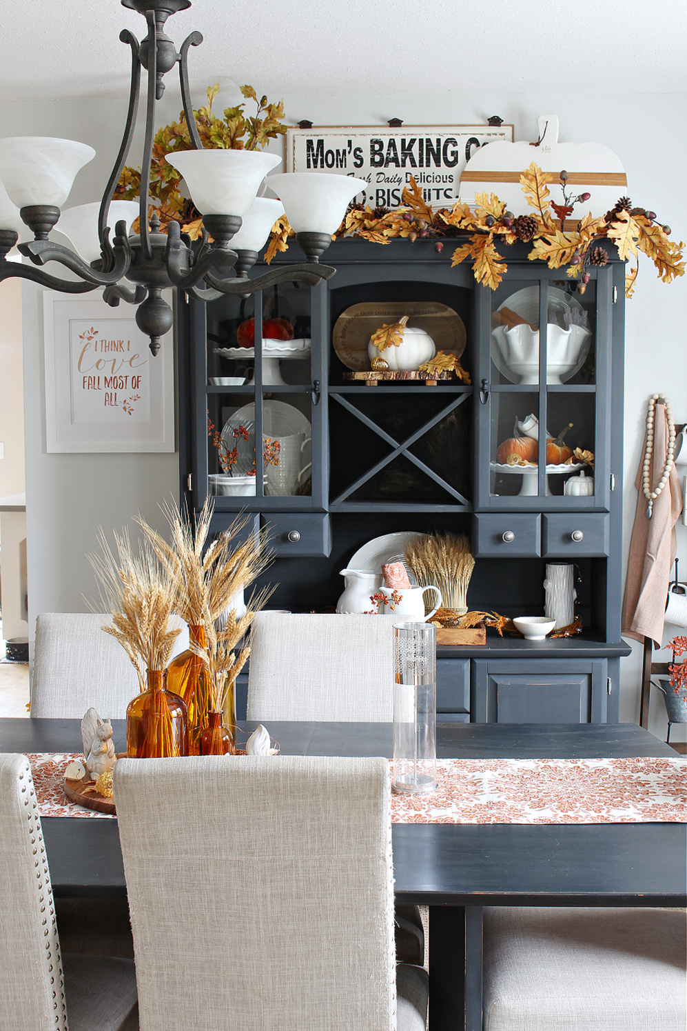 Fall dining room with a painted black hutch and dining table.
