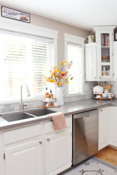 White kitchen decorated for fall with simple touches.