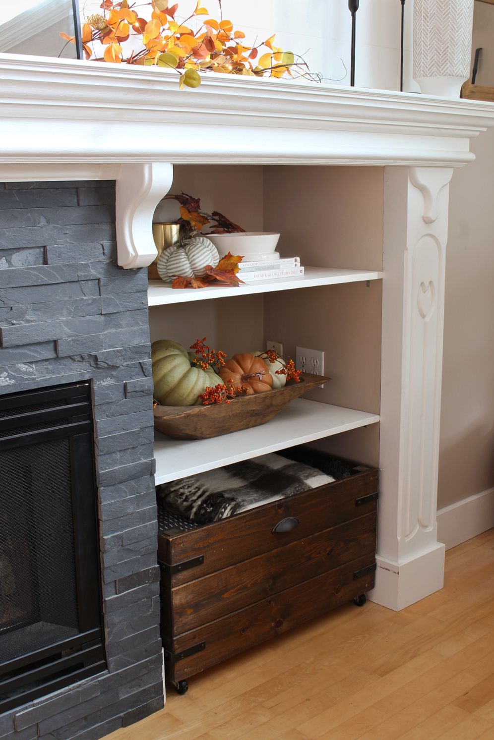 Shelves decorated for fall with a DIY wood crate.