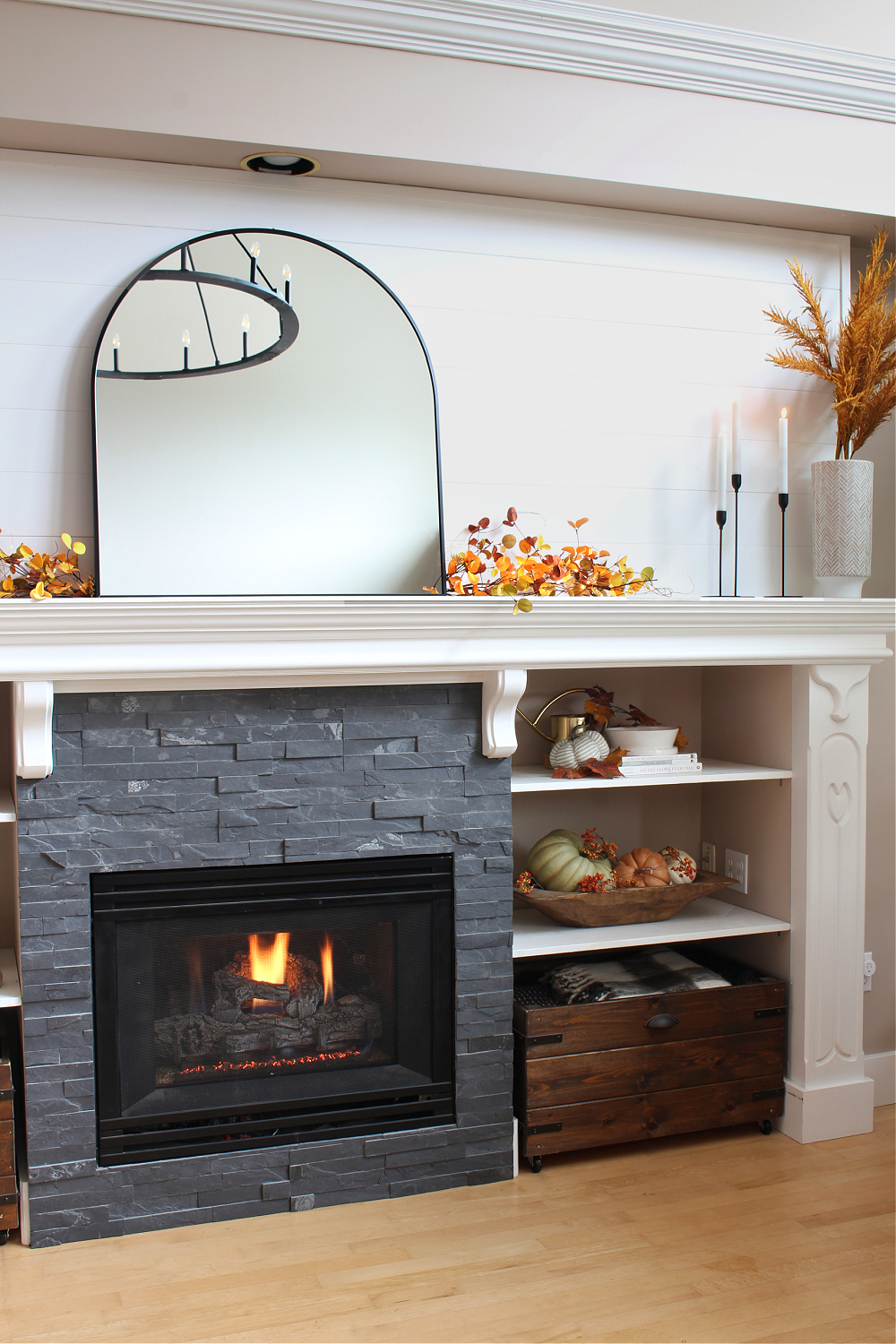 Pretty fall mantel decorating ideas with a white mantel.