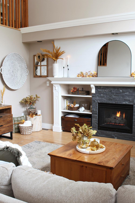 Modern fall mantel decorating ideas on a white mantel.