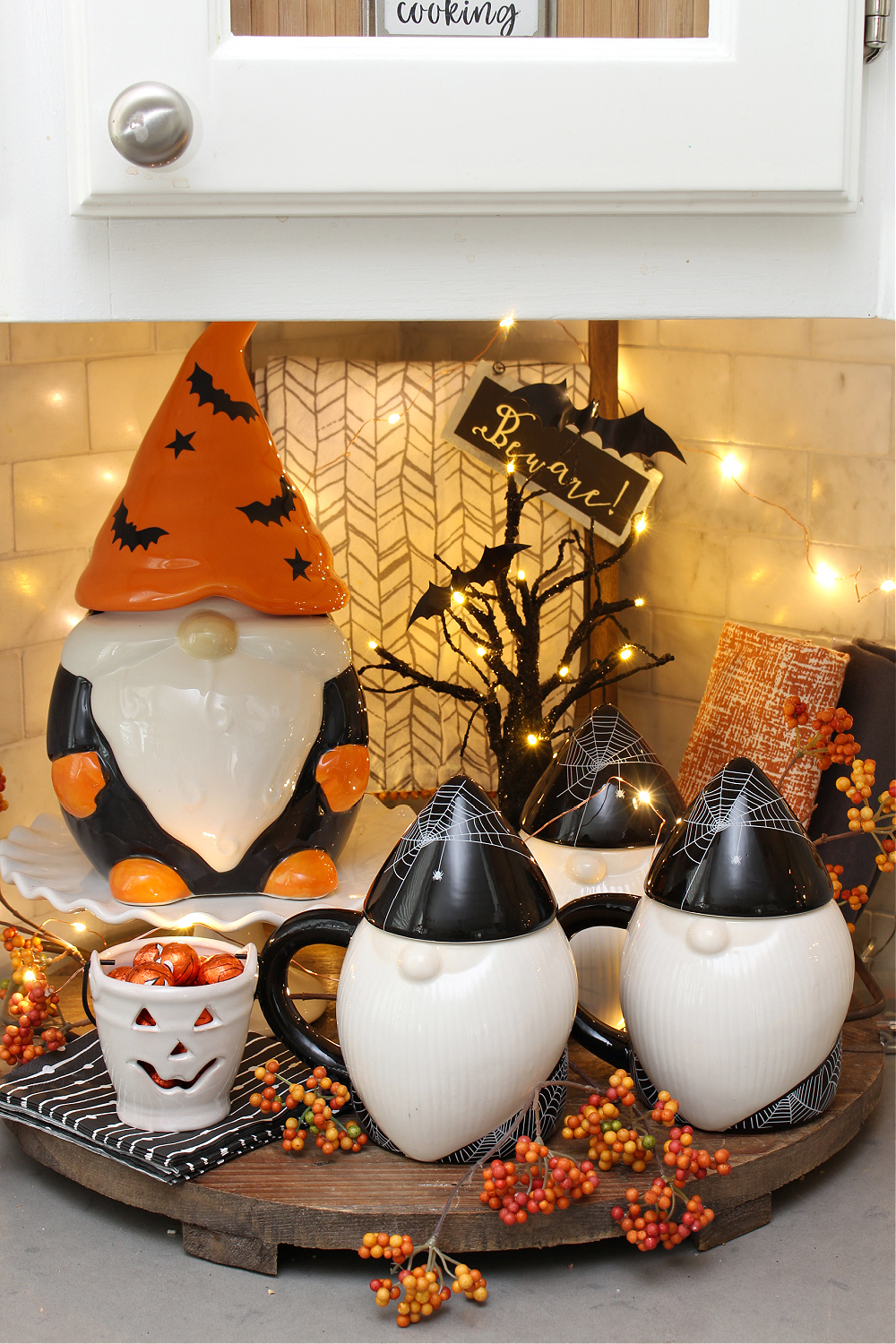 Cute Halloween vignette with Halloween gnome mugs and cookie jar.