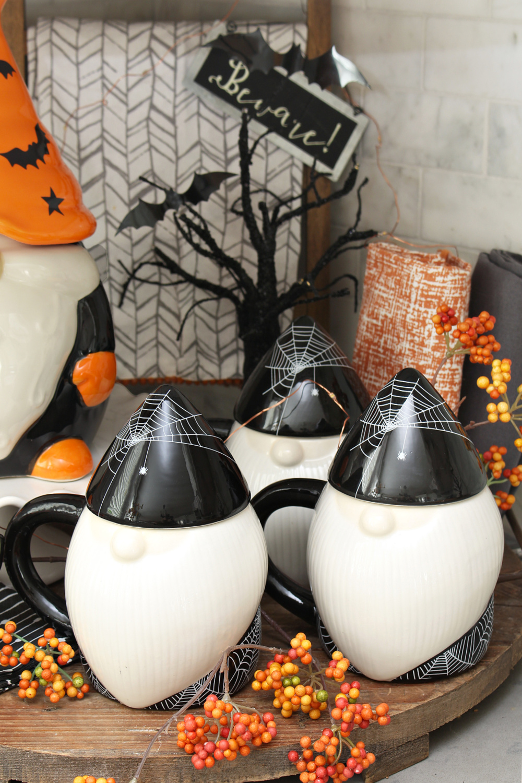 Halloween gnome mugs in a cute Halloween display.