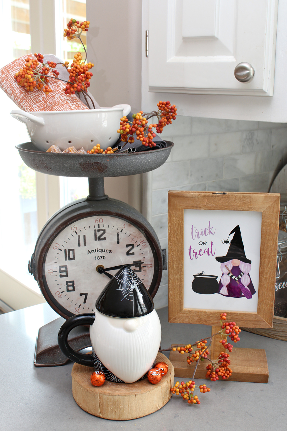 Halloween decor in a kitchen with gnome mugs and a free Halloween gnome printable.